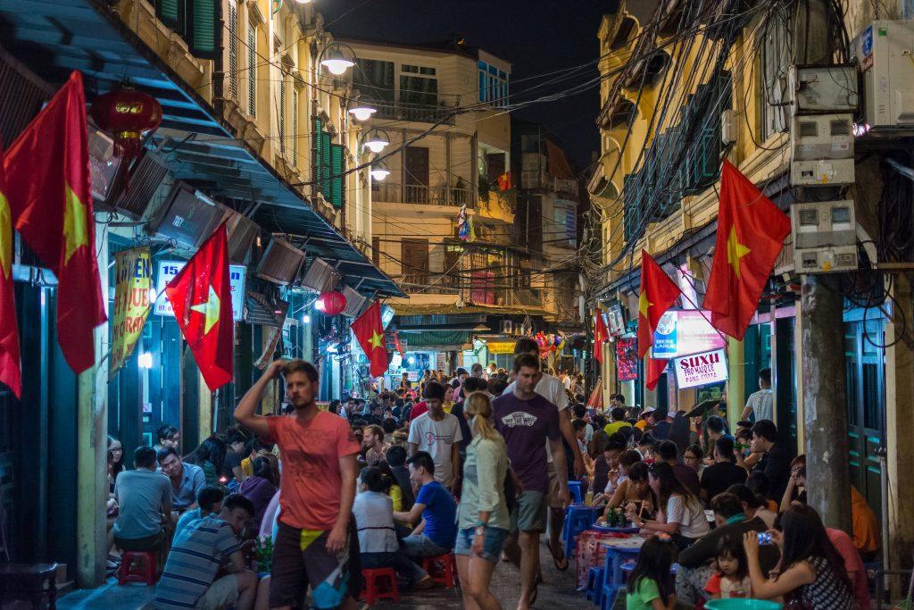 Vietnamese flags lining a street in Hanoi