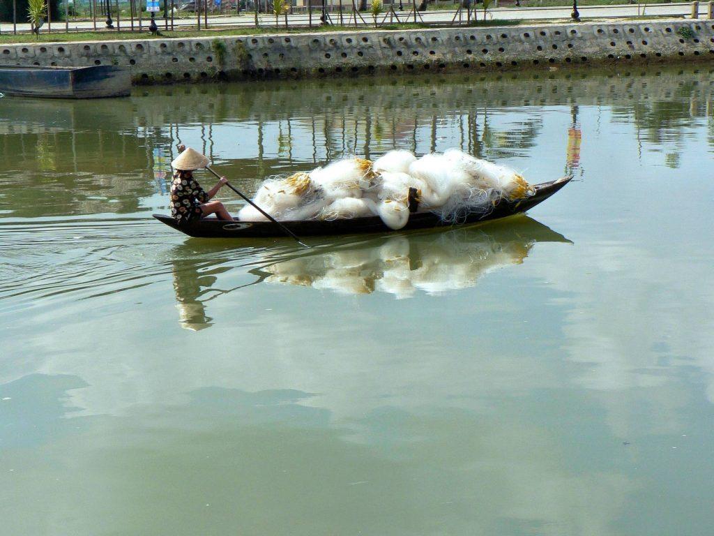 Silk being transported in Hoi An, Vietnam