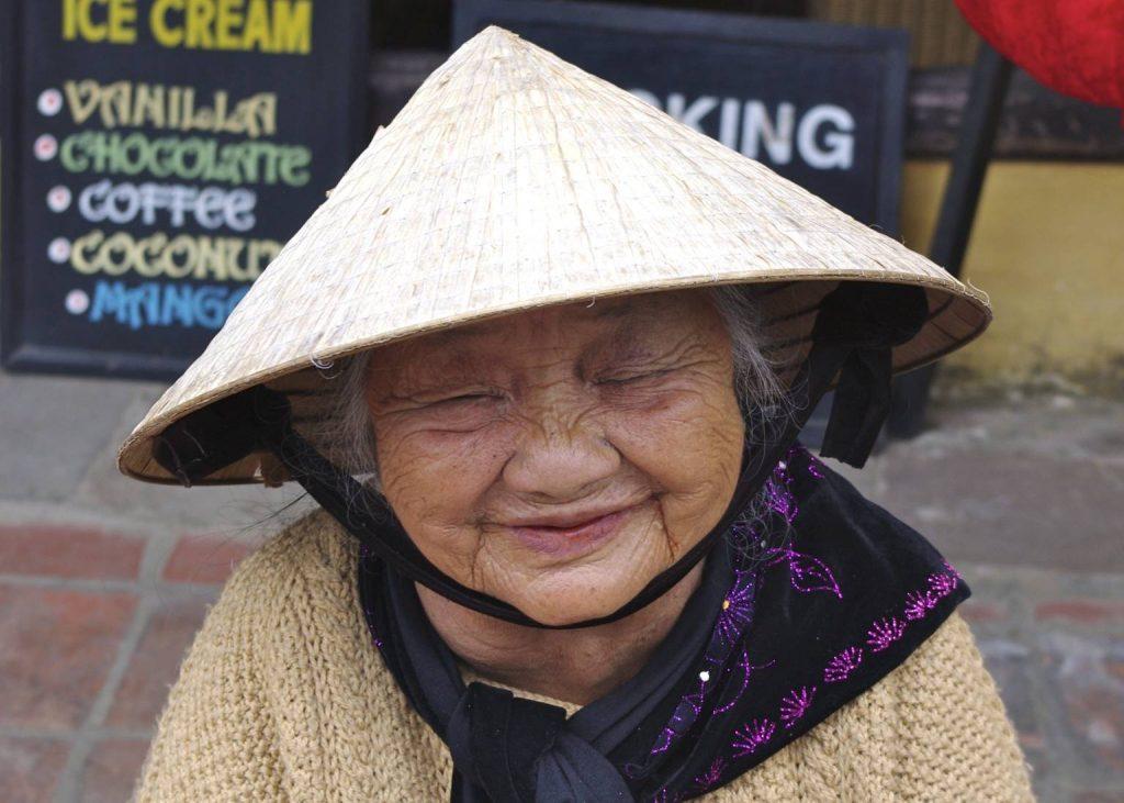 A Hoi, Vietnam local in a non la (Vietnamese conical hat)