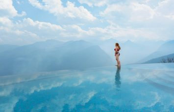 Woman standing in an infinity pool in Sapa, Vietnam