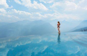 Woman standing in an infinity pool in Sapa, Vietnam