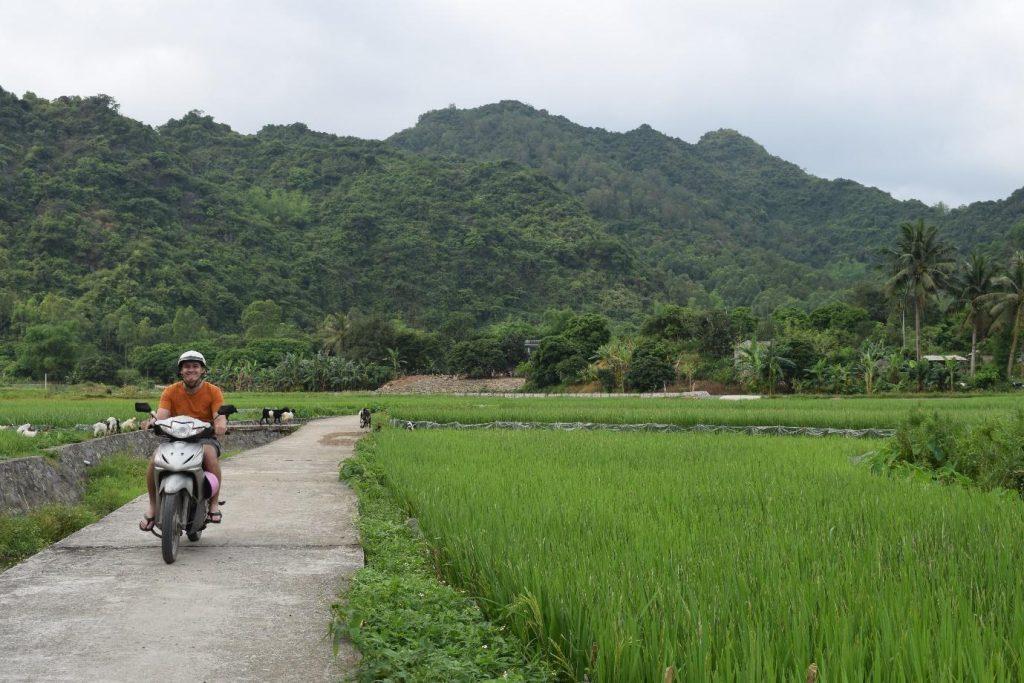 Jake of Untold Wanderlust riding a motorbike on Cat Ba Island