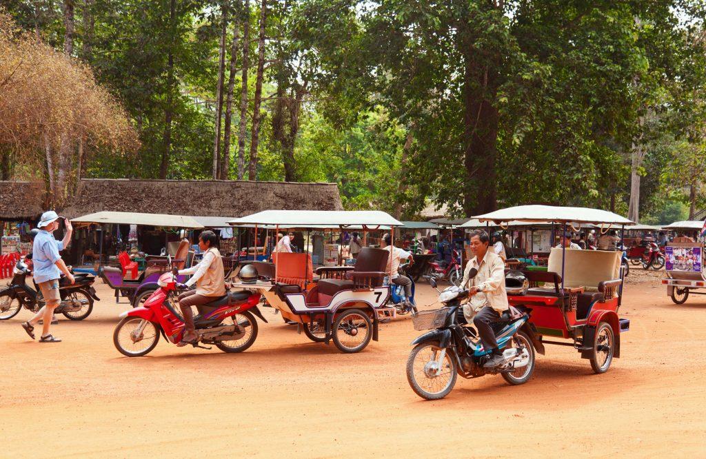 Tuk tuks in Cambodia by Angkor Wat