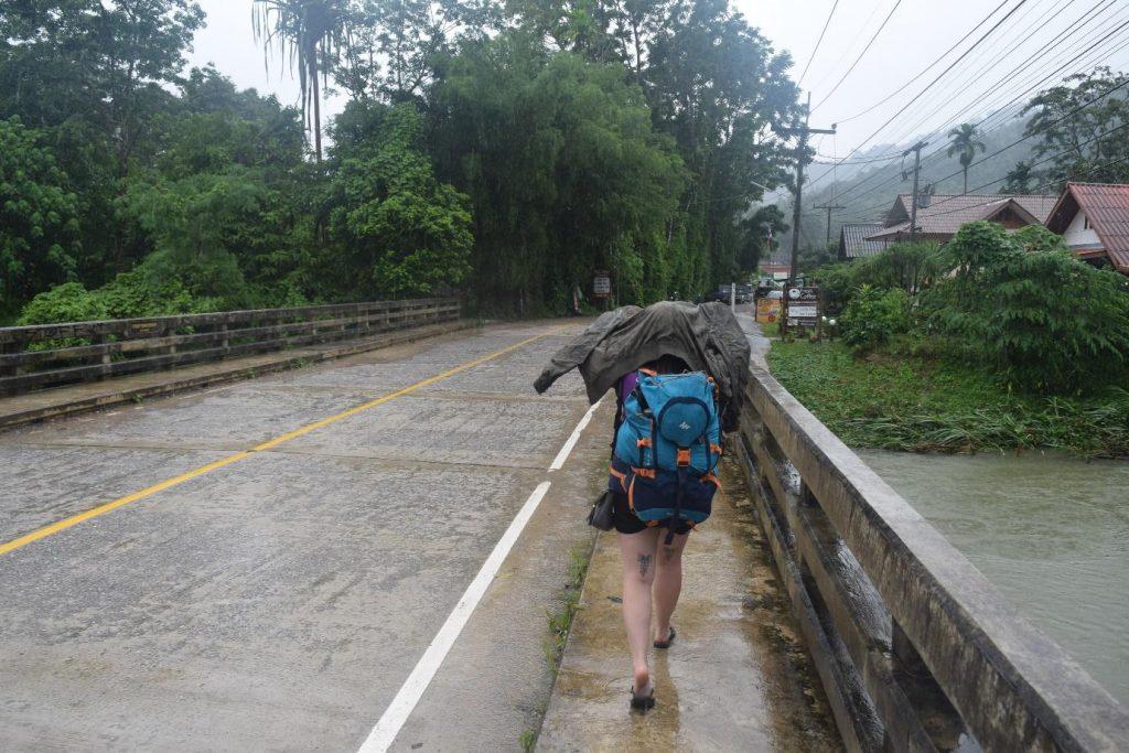 Katie and Jake of Untold Wanderlust walking in the rain