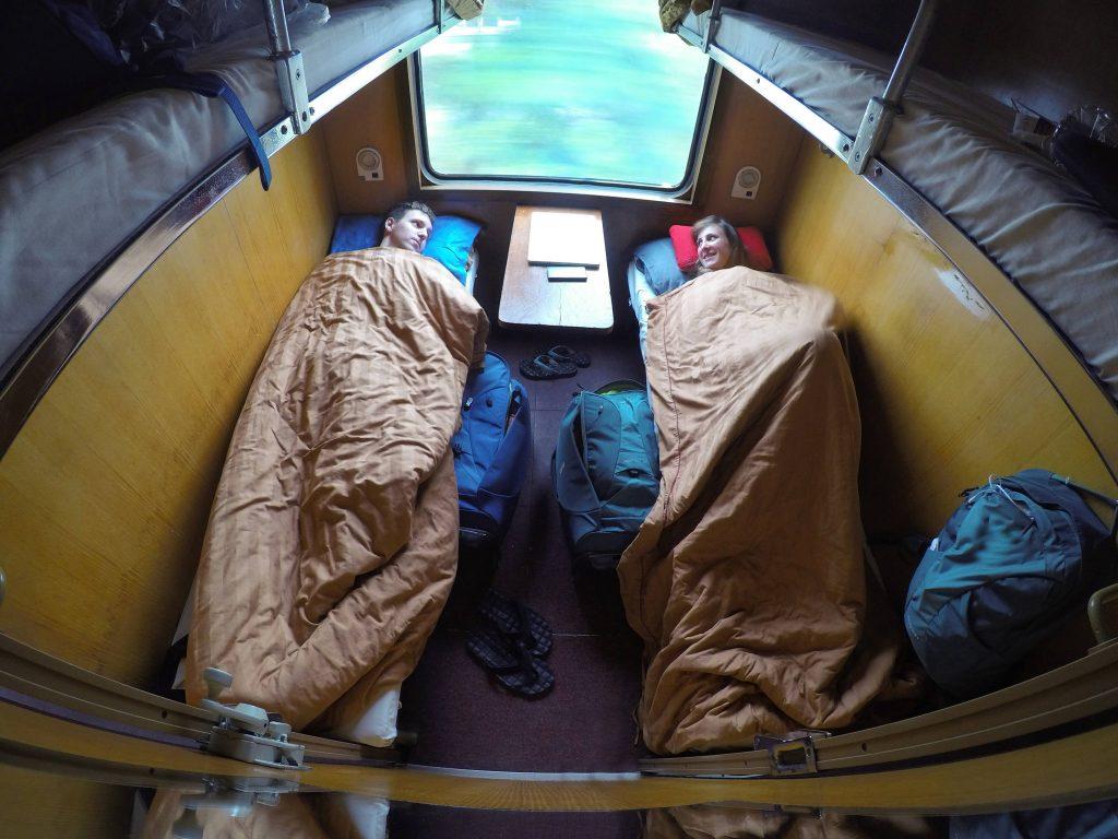 Couple riding a sleeper train
