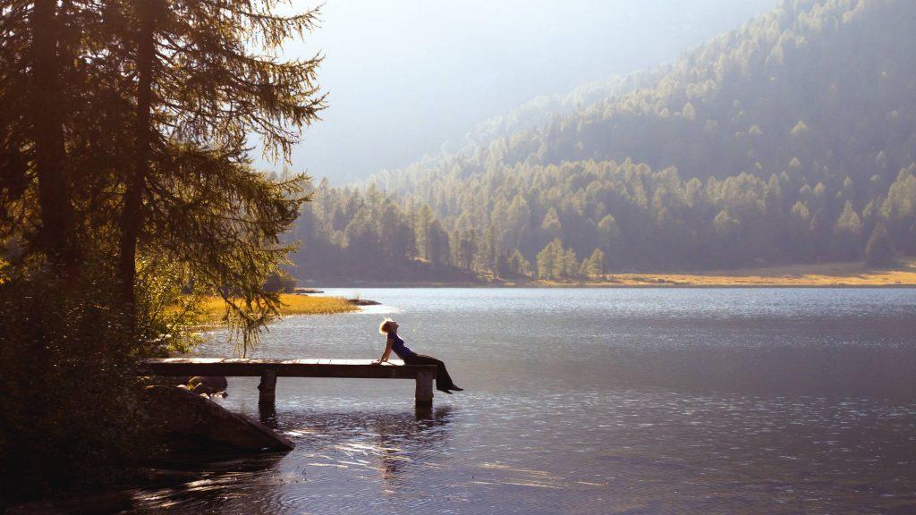 Solo female traveler at a mountain lake