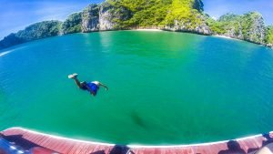 Man jumping into Halong Bay