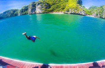 Man jumping into Halong Bay